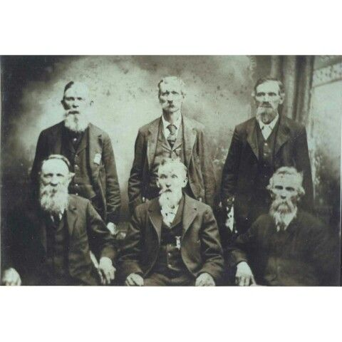"19th Indiana Volunteer Infantry Regimet Veterans. This photo shows John Bush (rear, middle) wearing his Iron Brigade medal. David Bush is at John's right, and George Bush sits in front and center, wearing his GAR medal. In 1861, when the three brothers mustered into Company 'I', which at that time was known as the ""Spencer Grays,"" John was 19, David 21, and George 32. The resolute brothers fought with the 19th until the regiment's 3-year enlistment ran out, and David and John were both…"