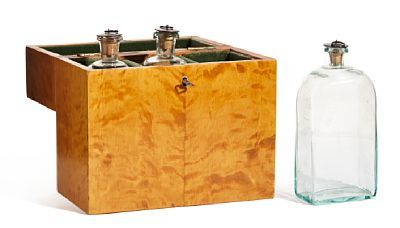 DECANT  Empire style. Mid-1900s.  Cash in birch interior dressed in velor. 3 bottles in clear glass w / stopper. Key included.