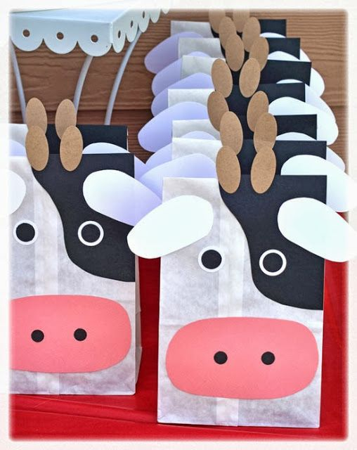 party favor bags: Inside were farm animal crackers, 'cow pies' (chocolate covered raisins), Cow Tales, and a farm puzzle