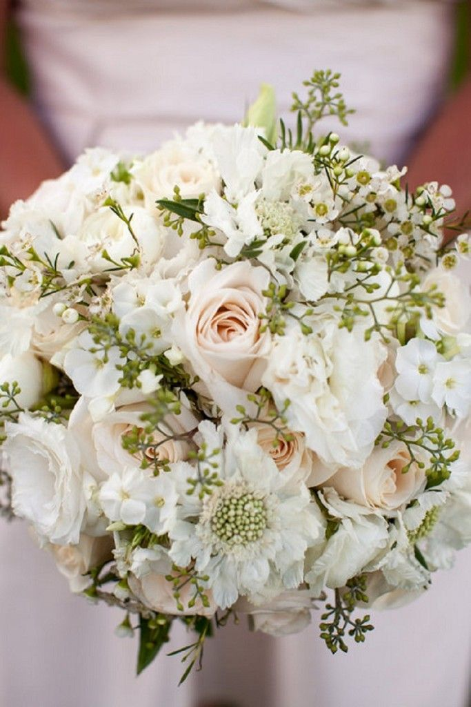 Contents: Vendela cream rose, white scabiosa, white phlox, seeded eucalyptus, white wax flower, and white lisianthus with no buds. Floral Design by Best Day Floral Design | Wedding Bouquet | Wedding Flower Inspiration: Floral Fridays | Elegant All White Bouquet