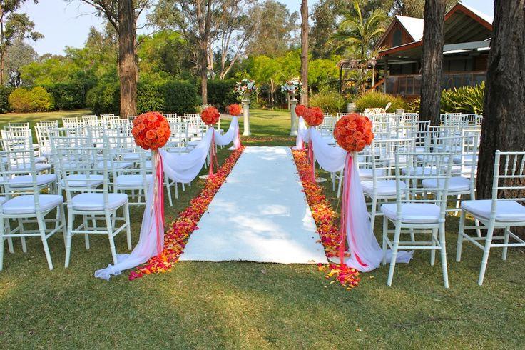 Gorgeous #wedding #ceremony with #roseballs on stands #white carpet aisle #rosepetals #Tamburlaine