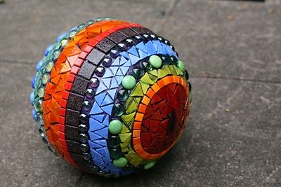 Inspiration: I think this a bowling ball but  I would like to try mosaic on old croquet balls