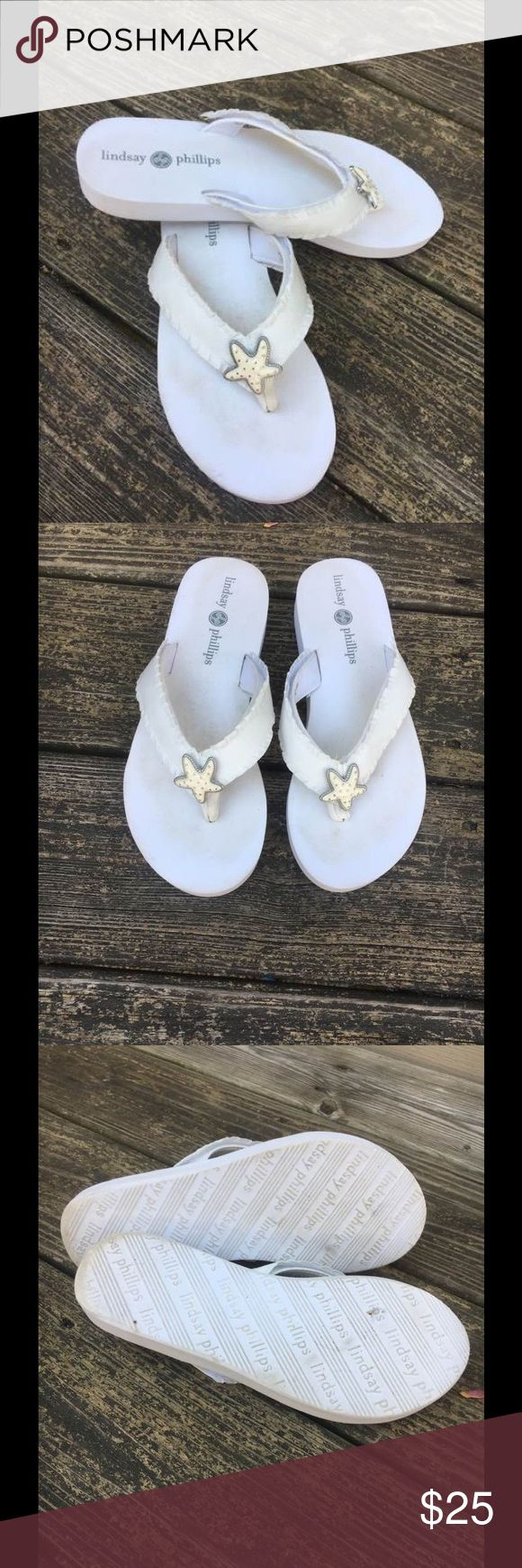 Lindsay Phillips 🏖White Switch Flops w/starfish White Lindsay Phillips Switch Flops Flip Flops. Very good condition. The straps are attached with Velcro and can be switched with other straps. Star fish decoration on strap. Both the straps and Switch Flop can be washed off. Lindsay Phillips Shoes Sandals