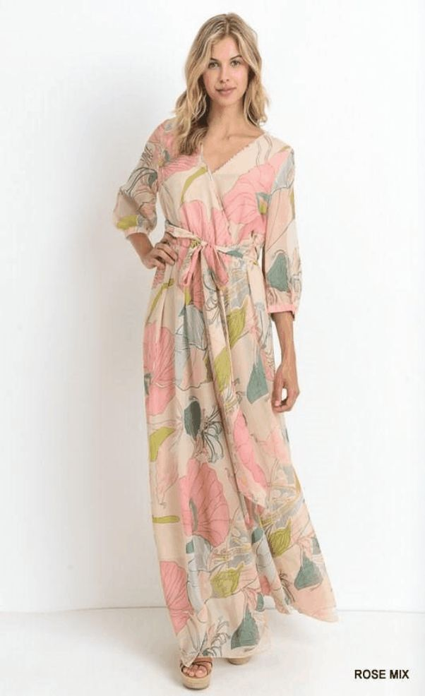 """Romance"" Leafy Print Wrap Maxi Dress $ 55.99 You know those long, lovely dresses you can put on and instantly feel amazing in with zero effort? Our ""Romance"" Wrap Maxi Dress is one of those. Whimsical wrap dresses like these are kind of our speciality. This is a chiffon wrap maxi dress with long sleeves and a fitted tie waist. Oh, and the skirt looks amazing when you walk - designed to show just a little bit of leg.  Fit: This garment fits true to size. Length: Floor length. Size small…"