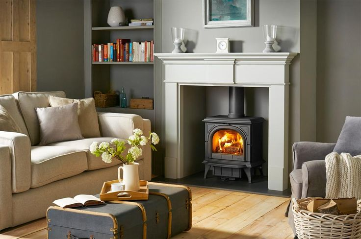The Pembroke wood mantel is available in a choice of materials and finishes: White, Warm White, Grey, Light Oak, Rich Oak, Waxed Oak, Lacquered Antique Pin