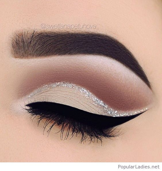 Nude eye makeup with silver glitter accent