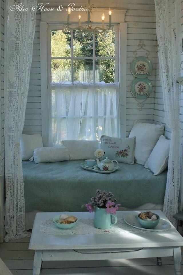 Love the lace curtains framing this shabby chic nook for reading and coffee/tea.