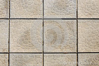 Wall with square textured panels. Shapes rocks.