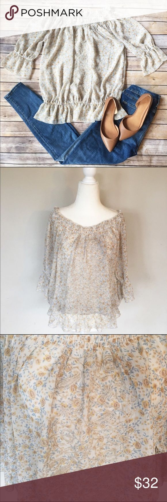 Free People Floral Embroidered Peasant Blouse This top is so beautiful & feminine with Boho vibes! Pair with skinny jeans, flats or booties. Embroidery on the front with light yellow and blue floral print. Elastic around bottom waist for billowing look and elastic at bottom of sleeve for a pretty flare. Neckline is elastic so it can be dropped down and worn along shoulders. Top of shoulder to bottom hem measures approx 26 in. armpit to armpit measures approx 21 in. Size is XS but would fit a…
