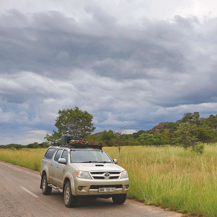 """Toyota Hilux kitted with Front Runner gear. Matopo Hills Zimbabwe.  _______________ Impress your friends with this fun fact: Matopo roughly translates to bald."""" _______________ #travel #frontrunneroutfitters #Africa #LiveTheFrontRunnerLife #frontrunnerpride #BornToRoam  Photo Credit: @dylandavieswildlife"""
