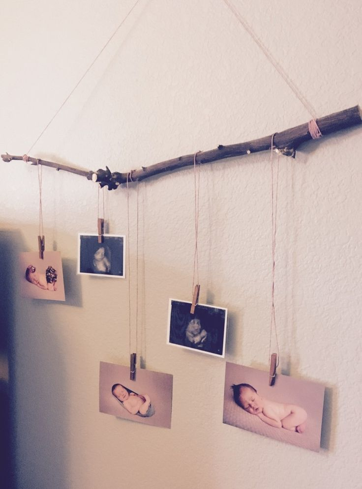 Love this tree branch mobile for displaying newborn photos - adorable!