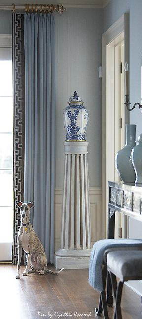 Draperies that go from ceiling to floor, with a header that allows them to stack back neatly along the window frame to let as much light in as possible.