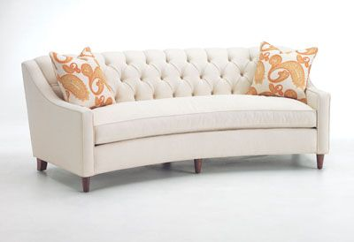 Flores Design Memphis Curved Sofa.  I love the tufted back, low arms, single cushion seat, simple legs.  Not sure about the curved shape.