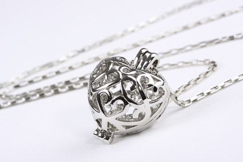Fancy Filigree Heart Pendant Silver – Jewel Online A gorgeous filigree heart supended on an oblong belcher link chain. Real Rhodium electroplated over brass. Length 90cm $139.90