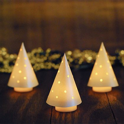 Glowing Mini Christmas Trees from paper cone and battery operated tea light                                                                                                                                                                                 More
