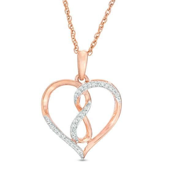 Zales 1/10 CT. T.w. Diamond Star Cluster with Flower Frame Pendant in 10K Rose Gold RdhytOZUx