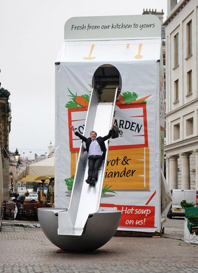 Giant soup carton arrives in Covent Garden- For every person down the ladle slide a bowl of soup was donated to the a homeless person.