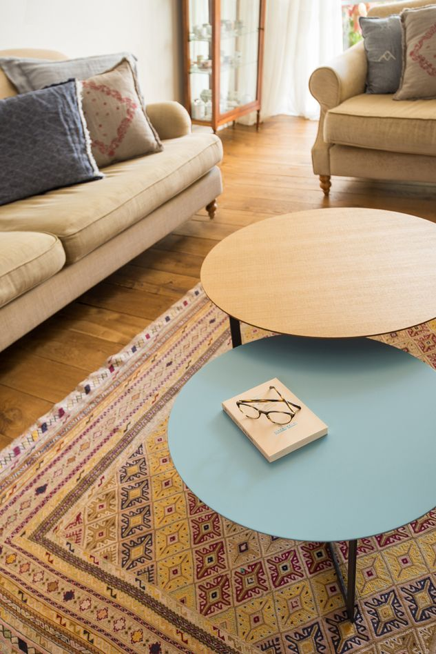 Wood and blue coffee tables in the living room. Mediterranean Chic by Liat Hadas.