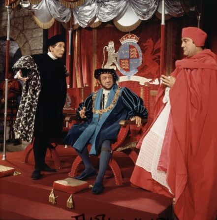 Kenneth Williams as Thomas Cromwell, Sid James as King Henry & Terry Scott as Cardinal Wolsey in Carry On Henry.