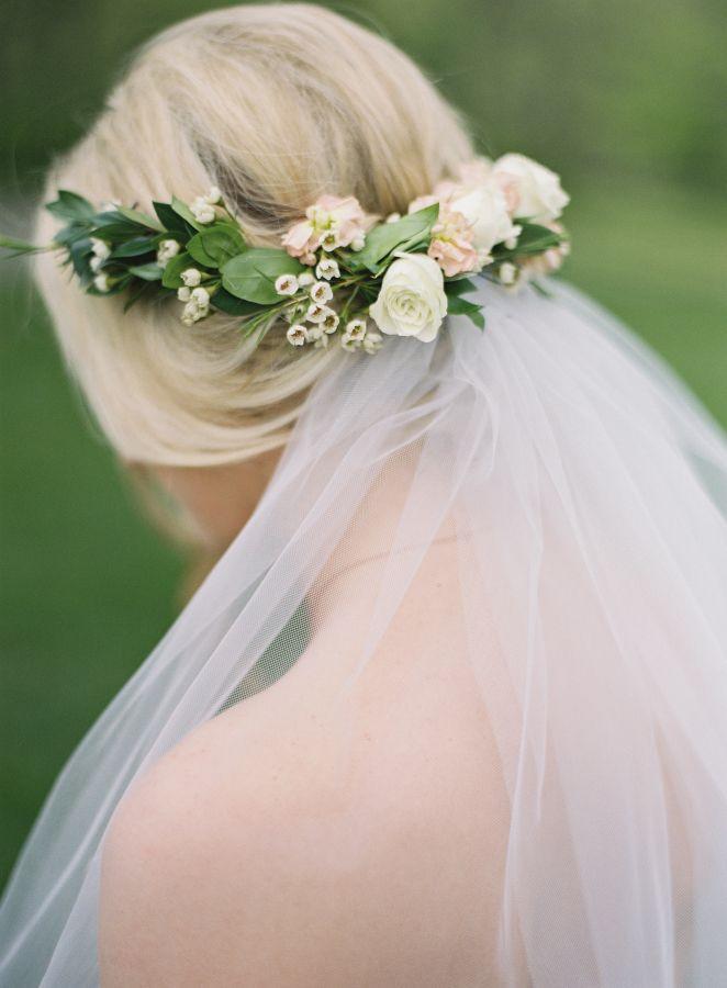 Romantic floral crown + veil: http://www.stylemepretty.com/2015/12/17/whimsical-kansas-city-outdoor-wedding/   Photography: Brett Heidebrecht - http://brettheidebrecht.com/