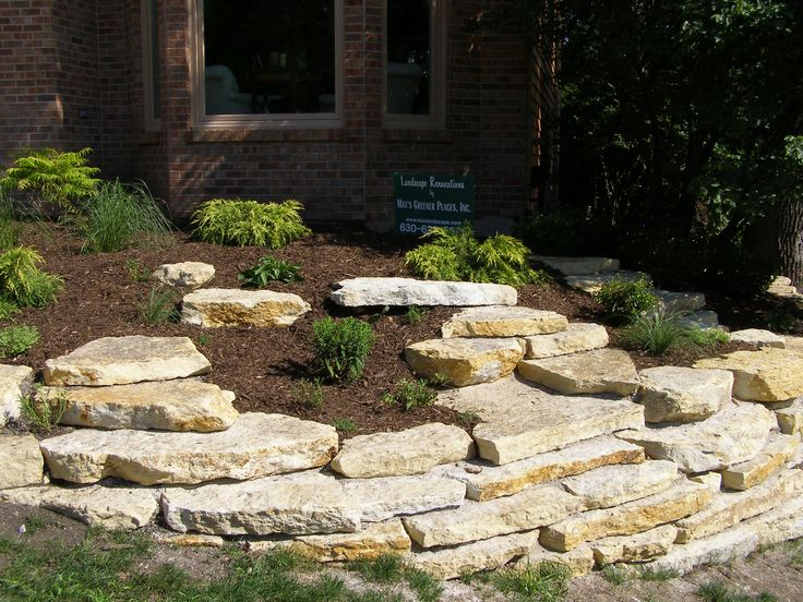 11 best images about limestone patio on pinterest fire for Stone wall landscaping ideas