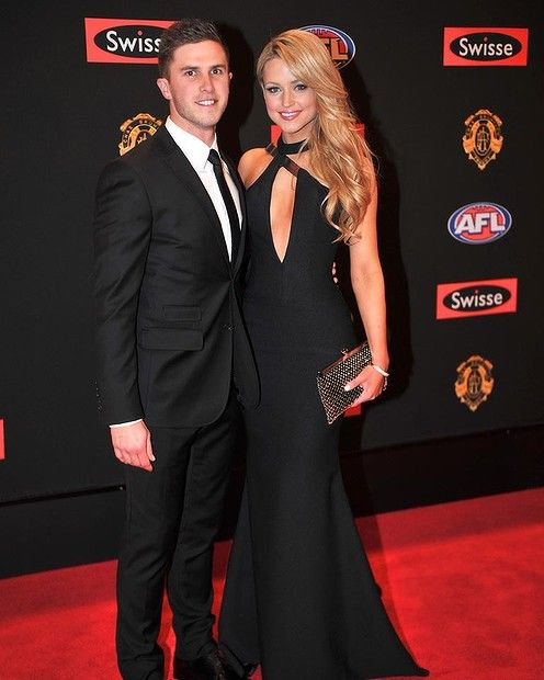 Marc Murphy and partner. the evening clutch bag. AFL Brownlow 2013