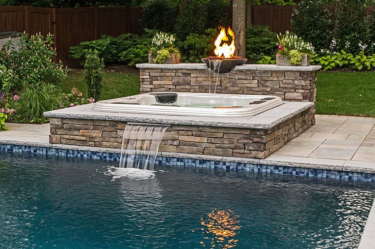 Inground Partially Recessed Portable Hot Tub With Fire Features And Spillway Waterfall Into