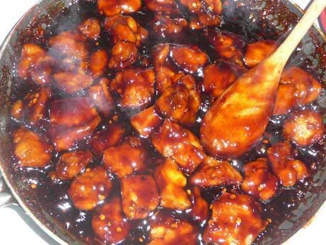 BEST Bourbon Chicken 2 pound boneless skinless chicken breast (bite-size pieces ) 1 tablespoon    olive oil 1 clove garlic ( crushed ) 1/4 tsp ginger 1/4 cup apple juice 1/3 cup brown sugar 2 tbl ketchup 1 tbl cider vinegar 1/2 cup water 1/3 cup soy sauce Heat oil. Add chicken pieces and cook until lightly browned. Remove chicken. Add remaining ingredients, heating over medium Heat until well mixed and dissolved. Add chicken and bring to a hard boil. Reduce heat and simmer for 20 minutes.