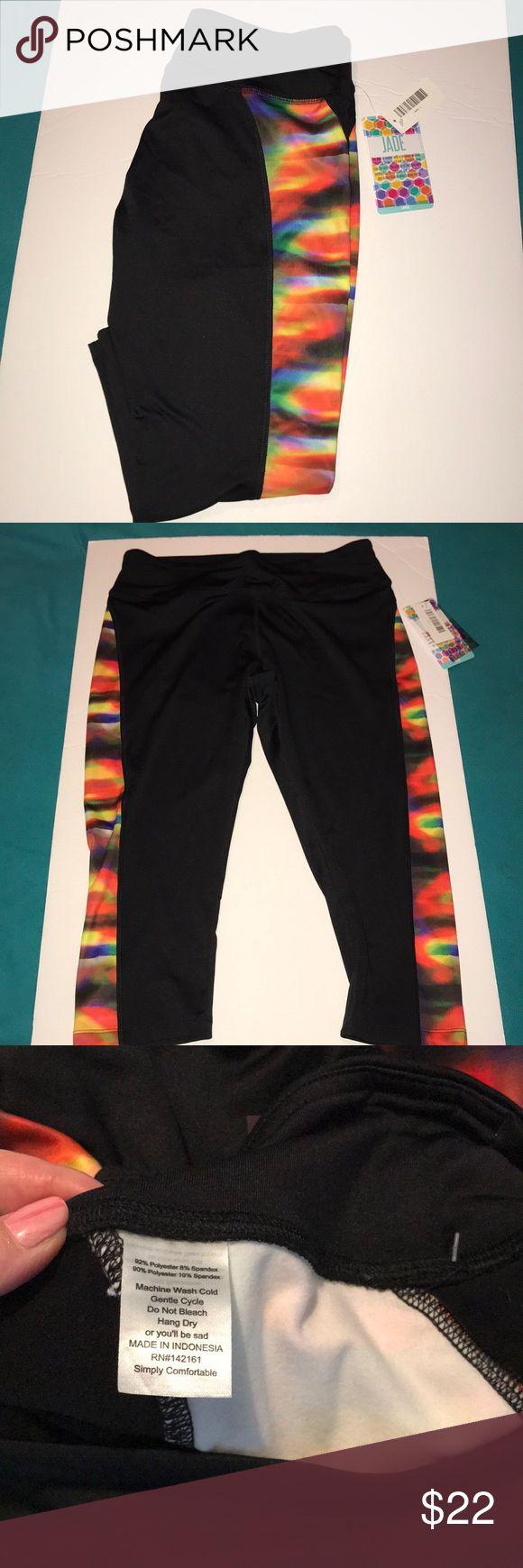 NWT Lularoe jade Capri workout pants NWT Lularoe jade Capri workout pants-these have a compression like typical workout pants do. Black with rainbow color sides. LuLaRoe Pants Capris