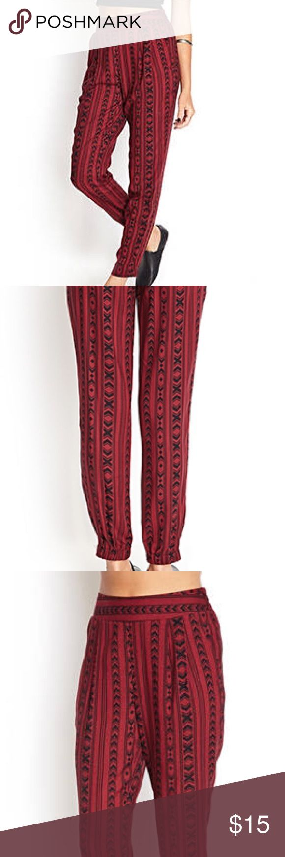 """ARROWHEAD HAREM PANTS MEDIUM,BURGUNDY/BLACK - GUC  These soft woven harem pants feature a Southwestern-inspired arrowhead print and elasticized waist. Complete with slanted front pockets, a welt back  pocket, and elasticized leg openings.  Unlined   Lightweight   100% rayon   28"""" inseam, 28"""" waist, 11"""" rise   Measured from Small   Machine wash cold   Imported   Model Info: Height: 5'7"""" 