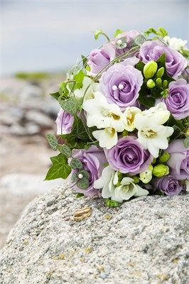 elegant bridal bouquet of ivory freesias, ivy and lilac roses