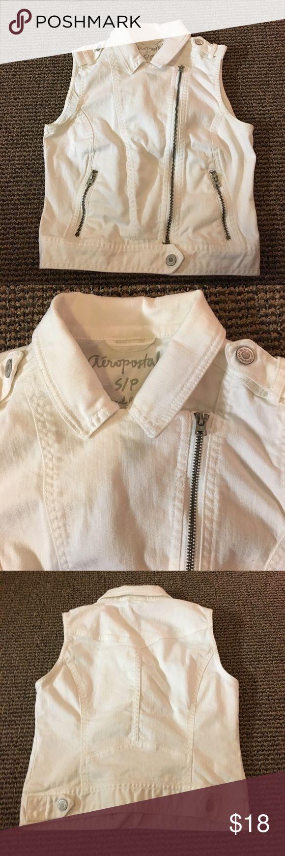 "Women's White Aeropostale Denim Vest Women's S/P white denim vest by Aeropostale                 Approximate Measurements:                                                Chest seam to seam:  16""                                                       Length (back under collar to bottom of vest:  17"" Aeropostale Jackets & Coats Vests"