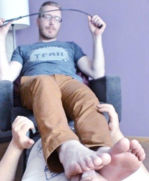 Lick male feet