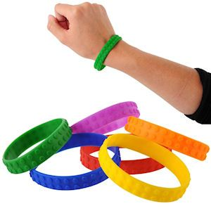 SILICONE BLOCK MANIA BRACELETS. Transform your little guests into master builders with these building brick-themed stretch bracelets modeled after their favorite building block toys. Each polybag with header contains 12 bracelets. Perfect for party favors, Easter basket treats and Christmas stocking stuffers.  One size fits most, packaging 6 X 6 Inches