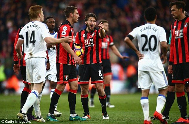 Arter (centre) is no flash Harry but he remains the glue that holds Bournemouth together