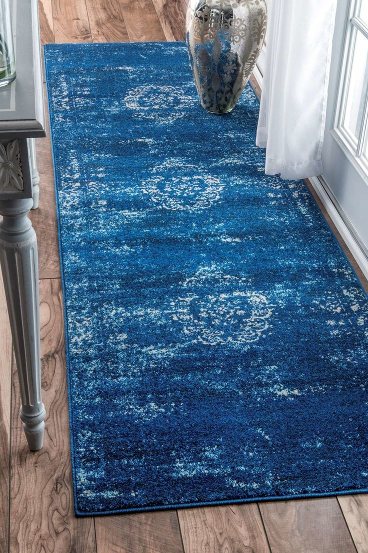 Features:  -Construction: Machine made.  -Material: 100% Polypropylene.  -Color: Blue.  Technique: -Machine woven.  Primary Color: -Blue.  Product Care: -Regular vaccuming helps rugs retain their beau