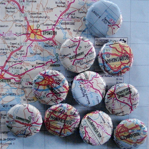 How fun would it be to make magnets for the fridge?  No directions here but think a map, a bottle cap, some ModPodge and a magnet and you would be good to go!  I see some crafting for Christmas in my future ;-)