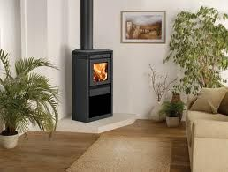 view of a corner installation of a wood burning stove - Google Search