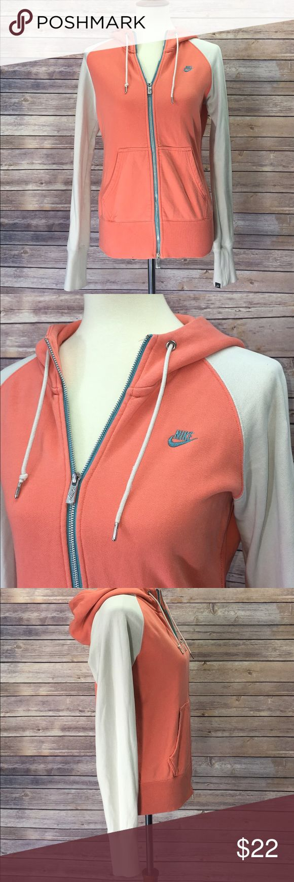 "Nike SportsWear Women's Zip Up Hoodie Size Medium 🔹Colors: Peach/Turquoise/Cream                                    🔹Worn In But In Good Condition (All Details In Pics)      🔹100% Cotton                                                                    🔹Length: Shoulder to Bottom 24.5"" (Laid Flat)               🔹Armpit to Armpit: 20"" (Laid Flat) Nike Tops Sweatshirts & Hoodies"