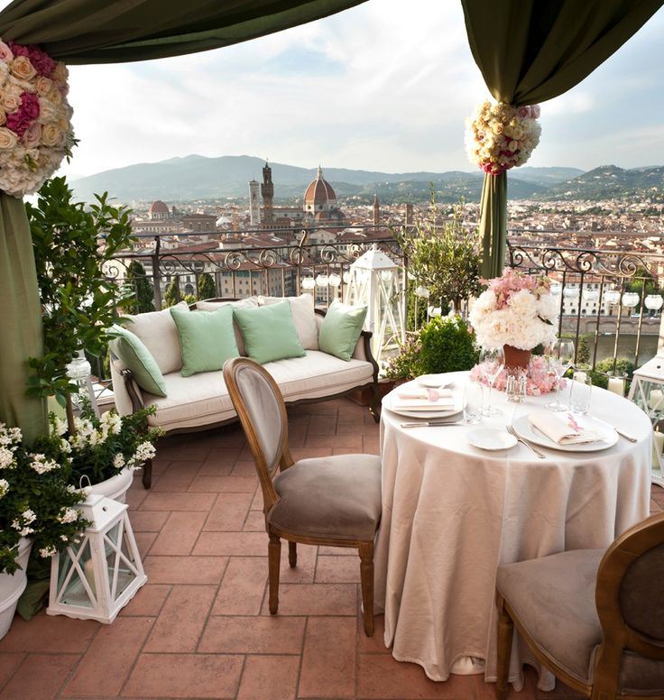 Dinner for two, with a rooftop Florence view. Florence Hotel Interior Designs