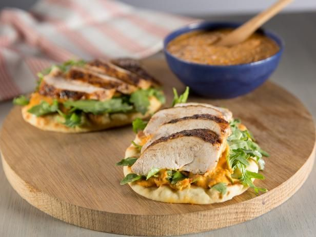 Get Spice-Rubbed Chicken Breast on Toasted Pita with Piquillo-White Bean Hummus and Arugula Salad Recipe from Food Network