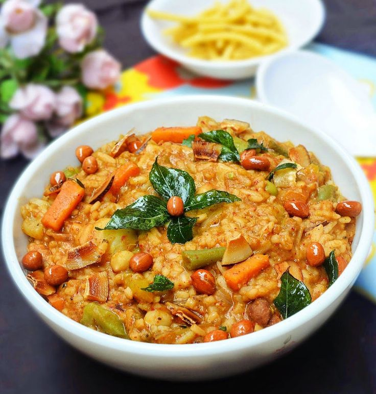 Literally translated as 'Hot (temperature) Lentil Rice' from the Kannada language, Bisi Bele Bath is an incredibly popular dish that originated in Karnataka and the surrounding region prepared in almost every Kannadiga home and served in most Southern Indian restaurants in and out of India. As the name suggests the dish is basically lentils and rice cooked along with vegetables, spices, and tamarind to produce an incredibly flavorful, nutritious, and filling dish