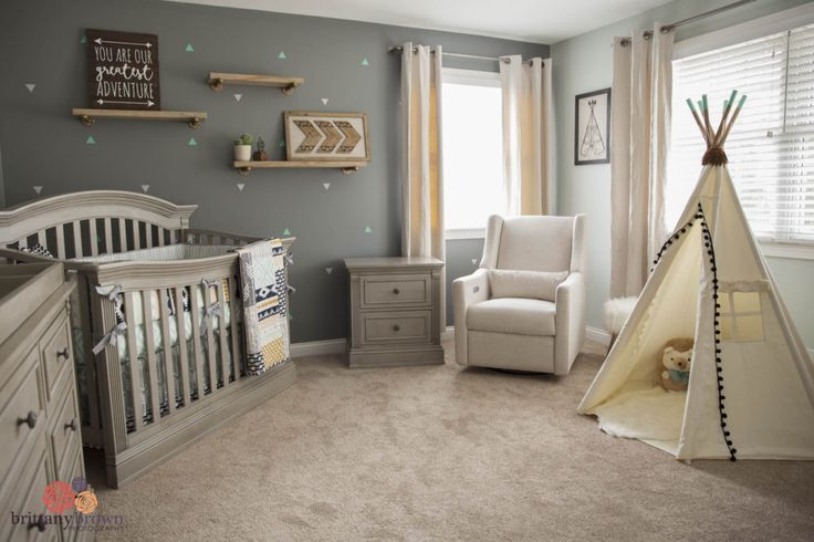 Such soft vibes in this nursery, even with the dark walls!