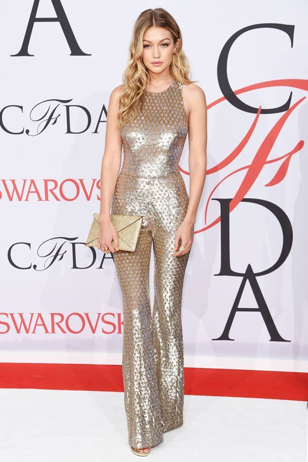 If Fashion Threw A Graduation, It'd Kinda Look Like This #refinery29  http://www.refinery29.com/2015/06/88361/cfda-awards-2015-best-dressed-red-carpet-pictures#slide-9  Gigi HadidFew people can pull off a gold-lamé, basketweave-fishnet, bell-bottomed jumpsuit, but Gigi Hadid has been a consistent red carpet daredevil. She pairs this Atelier Swarovksi crystal-covered Michael Kors number with an equally shiny, golden envelope clutch.