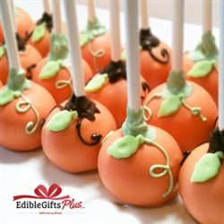 Pumpkin Cake Pops - Perfect for Halloween or Thanksgiving! Created by mixing a fresh cake with butter cream then dipping each into gourmet chocolate. The cake pop has a hard chocolate shell with very moist cake inside--similar to a rich brownie or cookie dough. -