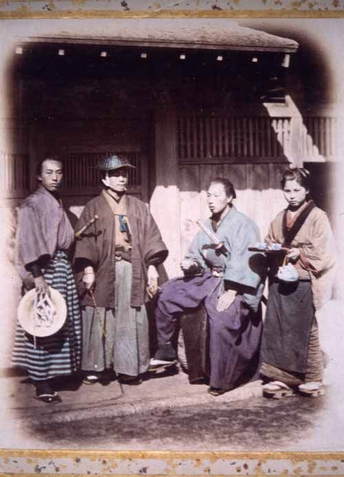 Samurai, Felice Beato photograph (tinted)   Japan, c. 1860s. The samurai second from the left is holding a muchi (whip).