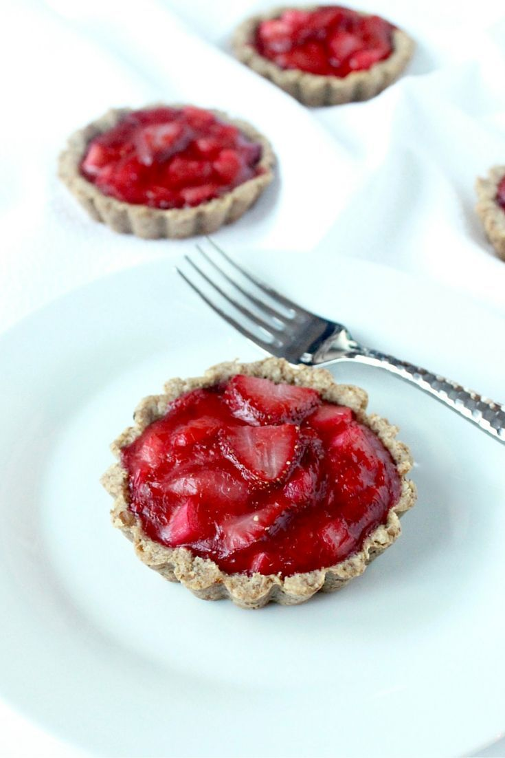 Strawberry Rhubarb Tartlets | Easy, gluten free tartlets with a simple pecan crust and a delicious strawberry rhubarb filling are the perfect tiny springtime dessert! | Via LivelyTable.com