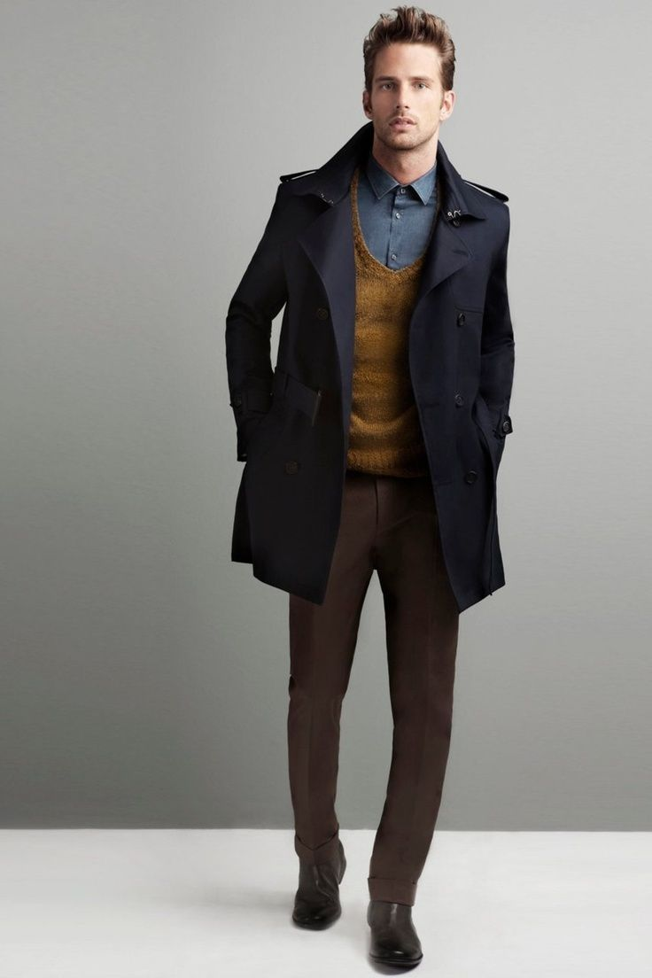Shop this look for $285:  http://lookastic.com/men/looks/dress-shirt-and-v-neck-sweater-and-pea-coat-and-dress-pants-and-chelsea-boots/1301  — Blue Dress Shirt  — Mustard V-neck Sweater  — Charcoal Pea Coat  — Brown Dress Pants  — Brown Leather Chelsea Boots