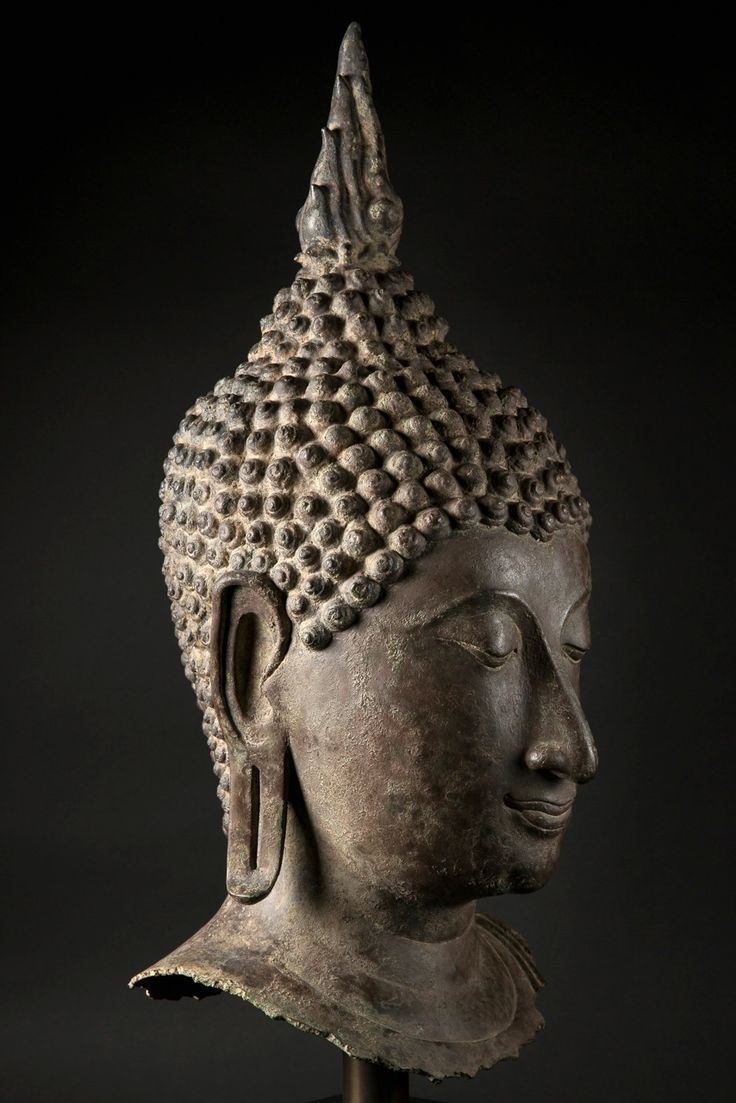 FIGURE OF THE MARTIAL BUDDHA. THAILAND, SUKHOTHAI KINGDOM AD 1238-1438 MOULDED BRONZE WITH THE LOST CAST METHOD AND TRACES OF ANCIENT GOLD. Height: 56 cm