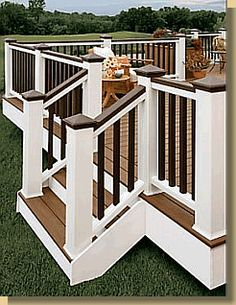 Nice contrast provided by blending natural wood tones with bright white and dark painted deck rails.